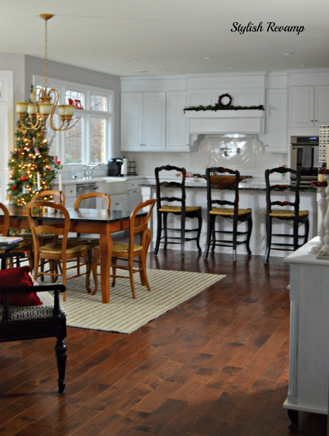 White kitchen with hickory hardwood flooring