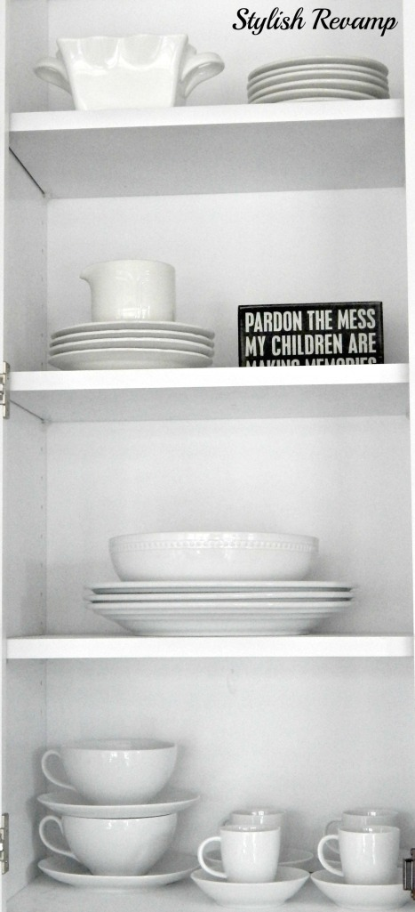 White dishes mixed with vintage white dishes on opening shelving.