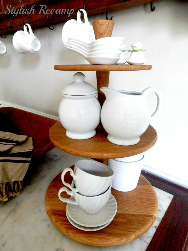 Wooden tiered stand with white dishes